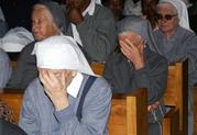 Catholic sisters react during the funeral of late Sister Leonella at the Consolata Shrine in Nairobi, Kenya, on Thursday, Sept 21, 2006.  Sister Leonella was killed in Somalia last Sunday by gunmen. (AP Photo/Sayyid Azim)